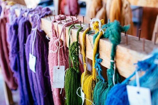 Multicolor woolen thread arranged on wood