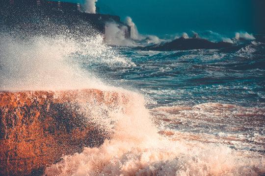 big waves crashing on the rocks