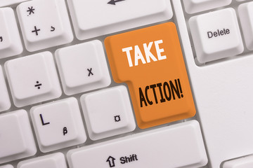 Text sign showing Take Action. Business photo text do something official or concerted to achieve aim with problem White pc keyboard with empty note paper above white background key copy space