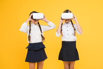 It is so real. children wear wireless VR glasses. Happy kids use modern technology. future education. back to school. Digital future and innovation. virtual reality. small girls in VR headset