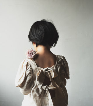 a girl with a  rose