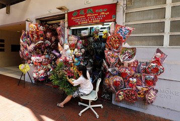 A flower seller prepares her bouquets near Wan Chai station in Hong Kong