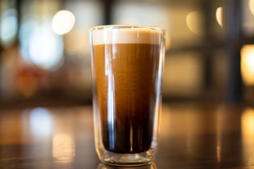 Beautiful texture and layers of Nitro Cold Coffee served in a dubble wall glass close up. Fototapete