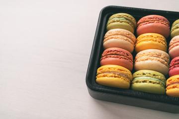 Foto auf Leinwand Macarons Macarons gift box cute assortment of yummy pastel colored macaron different flavours - pistachio, lemon, raspberry, vanilla.