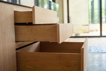 Opening wooden shelfs under installation inside the house under construction