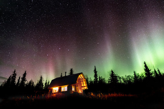 cabin under the dancing northern lights, Alaska