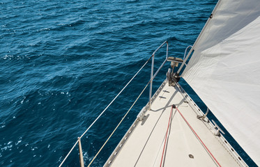 Picture of a sailboat bow and sail