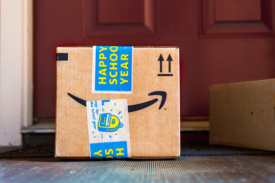 August 20, 2019 Sunnyvale / CA / USA - Amazon Prime delivery box with a Happy School Year sticker delivered at the door