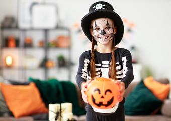 happy   child girl in skeleton costume to halloween.