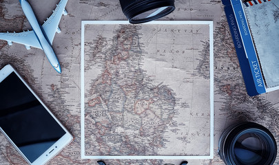 Travel concept. Map on the table andl aircraft.