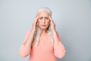 Close up photo of upset exhausted old lady suffering from strong headache reaction on magnetic storm and weather isolated grey background