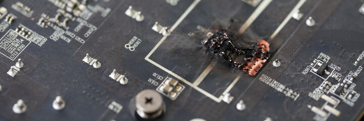 Closeup view of damaged graphic adapter burnt out after hack attack