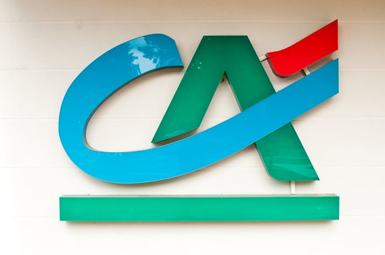 """MULHOUSE - France 19 May 2016 - retail of the logo of the bank """"credit agricole"""" french bank signage"""