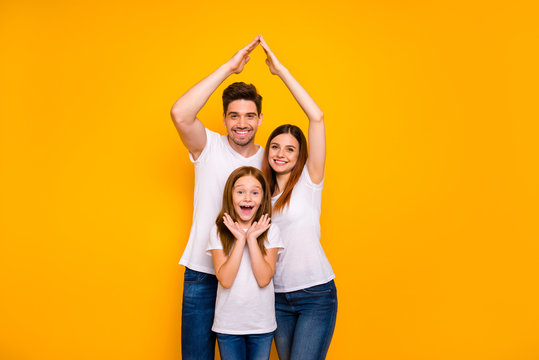 Daddy mommy and little foxy lady under protection on arms roof wear casual outfit isolated yellow background