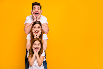 Portrait of three nice attractive charming lovely cute careful cheerful cheery stunned person in order of hierarchy unexpected great news isolated over bright vivid shine yellow background Wall mural