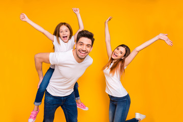 Portrait of three nice attractive charming cute lovely stylish trendy cheerful cheery carefree playful glad person having fun time dancing isolated over bright vivid shine yellow background