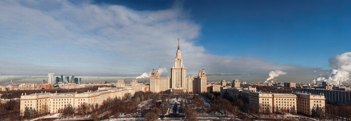 Panoramic top view of the building of Moscow State University in the winter sunny day. Moscow, Russia