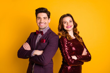 Portrait of his he her she nice attractive elegant charming smart serious content people standing back to back folded arms isolated over bright vivid shine yellow background