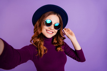 Close up photo of charming lady make photo video call touch accessory isolated over purple violet background