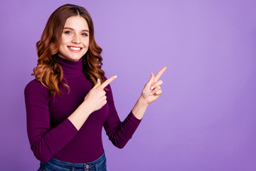 Portrait of her she nice attractive confident cheerful cheery positive wavy-haired girl pointing two forefingers ad advert copy space isolated over pastel purple violet lilac background Wall mural