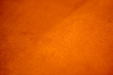 Orange reflective fabric background