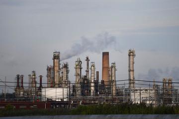 Smoke rises from oil refinery stacks at Philadelphia Energy Solutions plant in Philadelphia