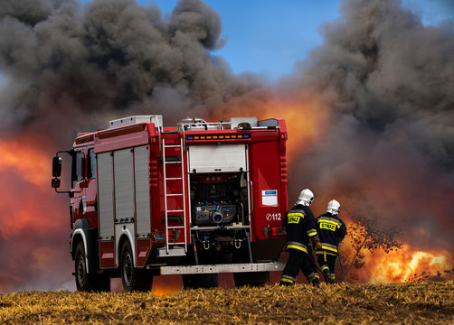 fire truck and firefighters during the fire extinguishing action
