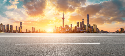 Photo Stands Shanghai Shanghai skyline and modern buildings with empty asphalt highway at sunrise,panoramic view.