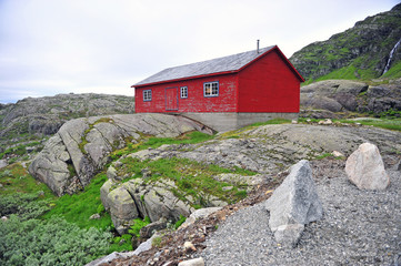 Traditional red wooden house in norwegian mountains