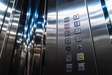 Elevator Buttons for Disabled Blind People with Braille Language Signs on Panel