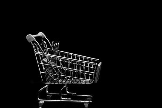 Shopping cart isolated on black background