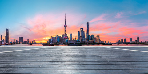 Aluminium Prints Shanghai Shanghai skyline and modern buildings with empty wooden board square at sunrise,China.