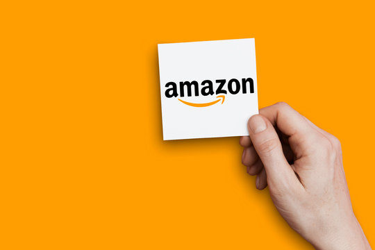 LONDON, UK - October 30th 2018: Hand holding Amazon logo. Amazon is the largest internet retailer in the world