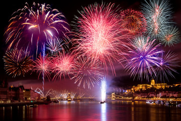 Colorful fireworks in Budapest august 20. at night - Buda Castle, Chain bridge, Danube and parliament in the background