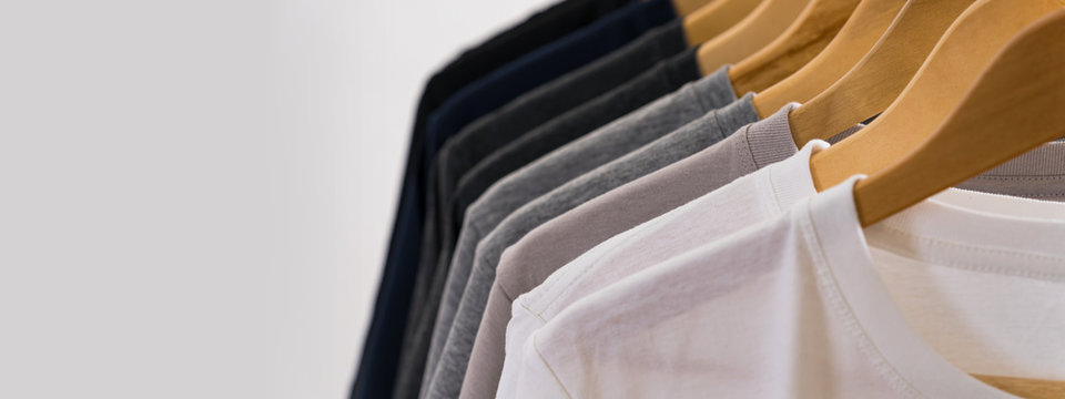 Close up of T-shirts on hangers, apparel background