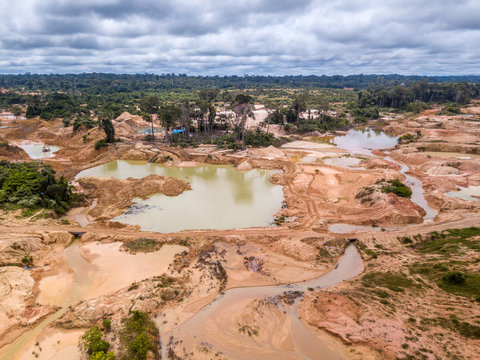 Aerial view of deforested area of the Amazon rainforest caused by illegal mining activities in Brazil. Deforestation and illegal gold mining destroy the forest and contaminate the rivers with mercury.
