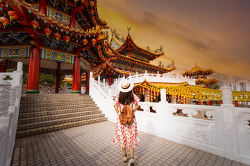Woman tourist is sightseeing inside Thean Hou Temple in Kuala Lumpur.