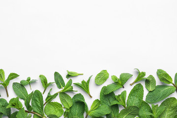 Fresh green mint leaves on white background, top view Wall mural