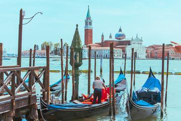 Foto op Canvas Gondolas gondolas in dock near pier church of sun giorgio maggiore on background