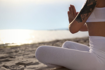 Young woman practicing zen meditation on beach, closeup. Space for text