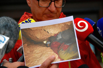 Mountain rescue team (TOPR) representive presents a picture from a search operation for two cave climbers trapped in the Tatra mountains during a news conference in Zakopane