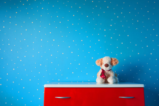 toy puppy in room