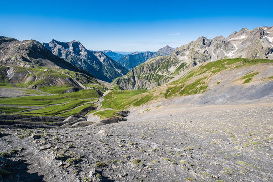 """View of the """"Drac Blanc"""" valley from the Vallonpierre Pass at the end of the Valgaudemar Valley, Ecrins National Park, French Alps"""