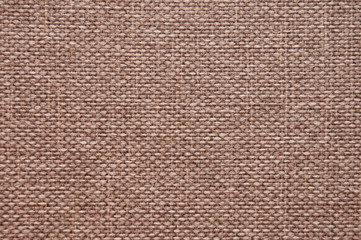 The texture of brown beige burlap. Natural background from woven coarse threads fabric