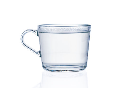Cup with pure water isolated on white background