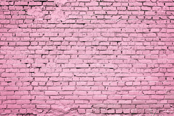 Bright trendy pink background of cracked brick wall