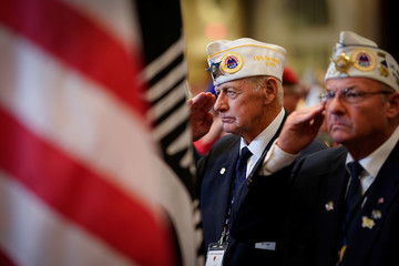 Veterans salute the flag before U.S. President Donald Trump speech the AMVETS (American Veterans) National Convention in Louisville