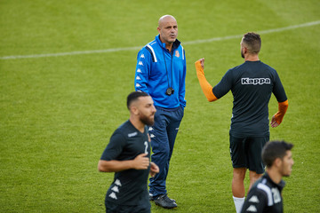"""Yosef """"Yossi"""" Abukasis, coach of Bnei Yehuda talks to players during a training session at a football stadium in Malmo"""