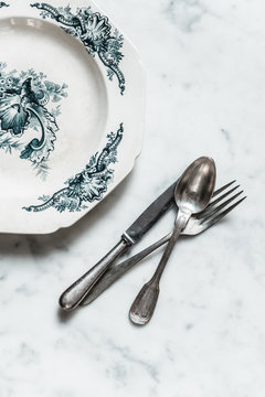 Cutlery and vintage plate