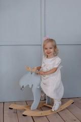 Little cute girl on the moose swing